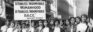 "a group of women holding a sign that says ""A Fearless Indomitable Womanhood A Fearless Indomitable Race"""