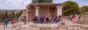 a group of people looking at an ancient building