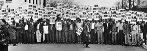 """a black and white photo of a group of men holding signs that say """"I am a man"""""""