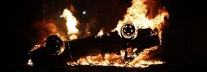 an upside down car on fire