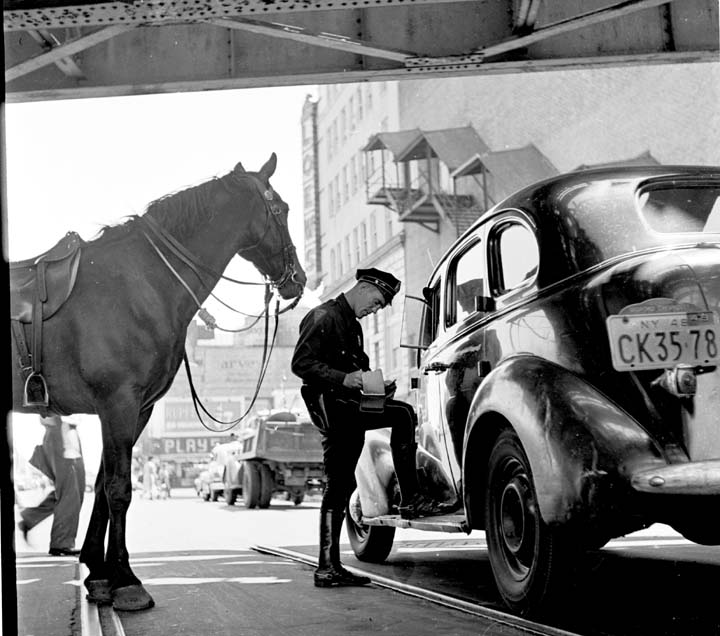 a black and white photo of a horse cop in Coney Island