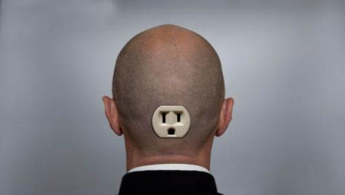 a man with a plug in the back of his head