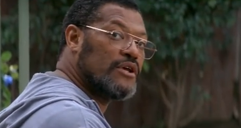 an African American man wearing glasses
