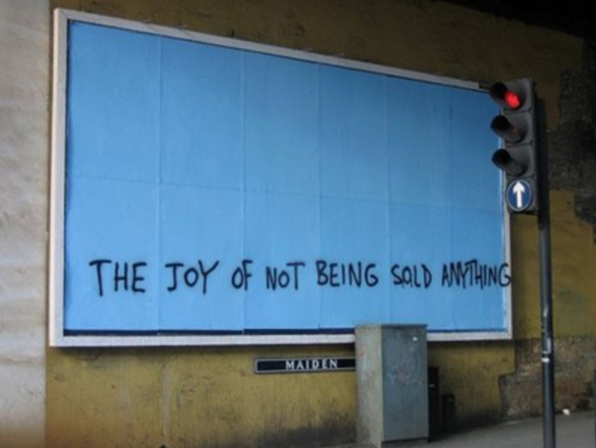 "A billboard reading ""The joy of not being sold anything"""