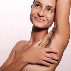 A woman with hair under her armpits