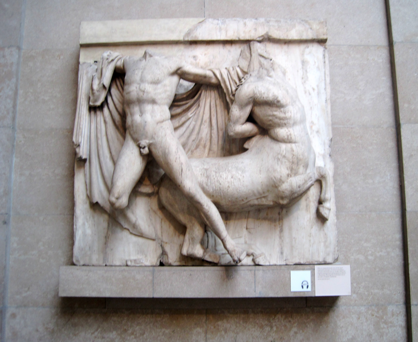 Statue on a wall of a man and a horse