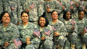 Women in the United State military holding American flags