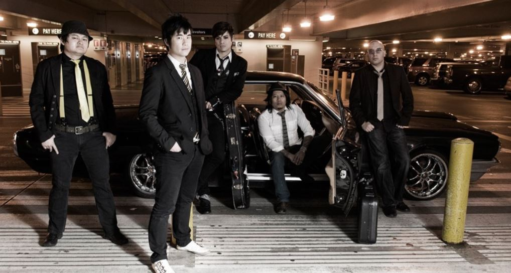 A group picture of the Slants in suits