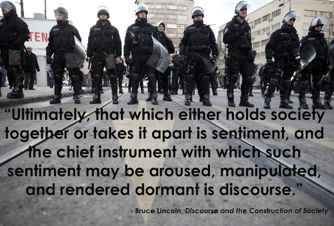 """soldiers standing around in their gear with text overlay reading """"Ultimately, that which either holds society together or takes it apart is sentiment, and the chief instrument with which such sentiment may be aroused, manipulated, and rendered dormant is discourse."""""""