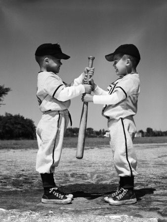 A black and white photo of two boys in baseball uniforms