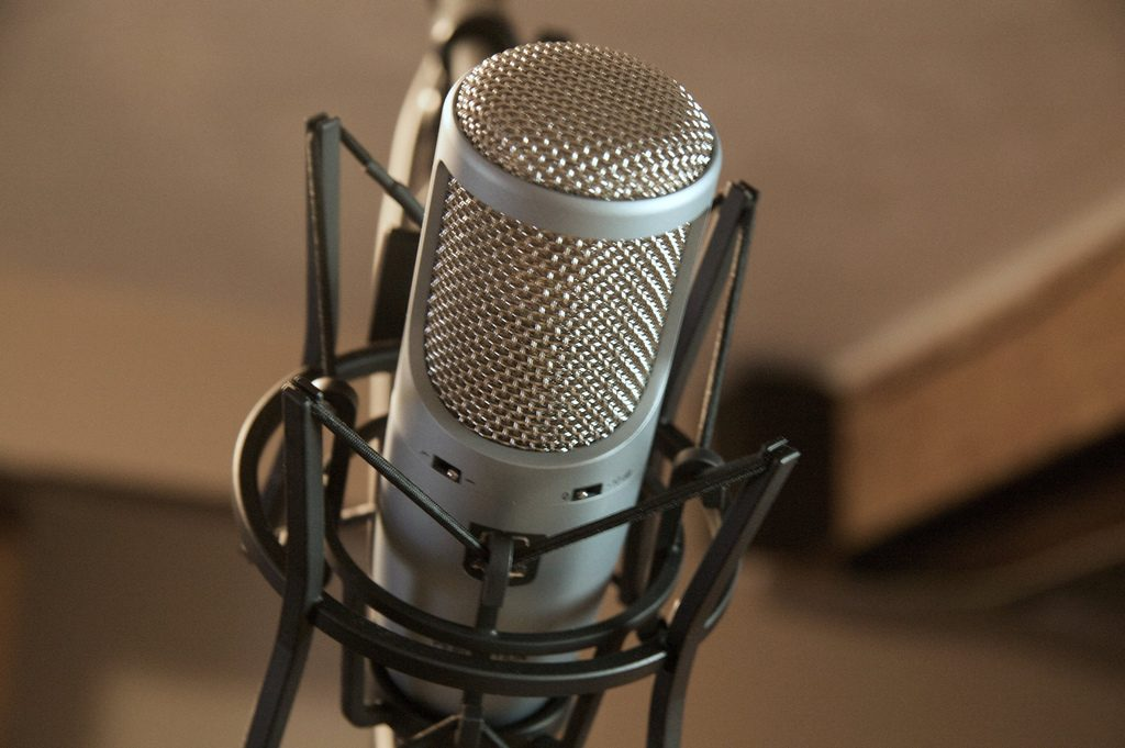 A silver microphone on a stand