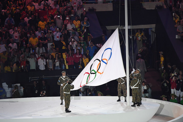 The olympic flag being raised
