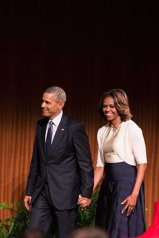An image of Michelle and Barack Obama holding hands