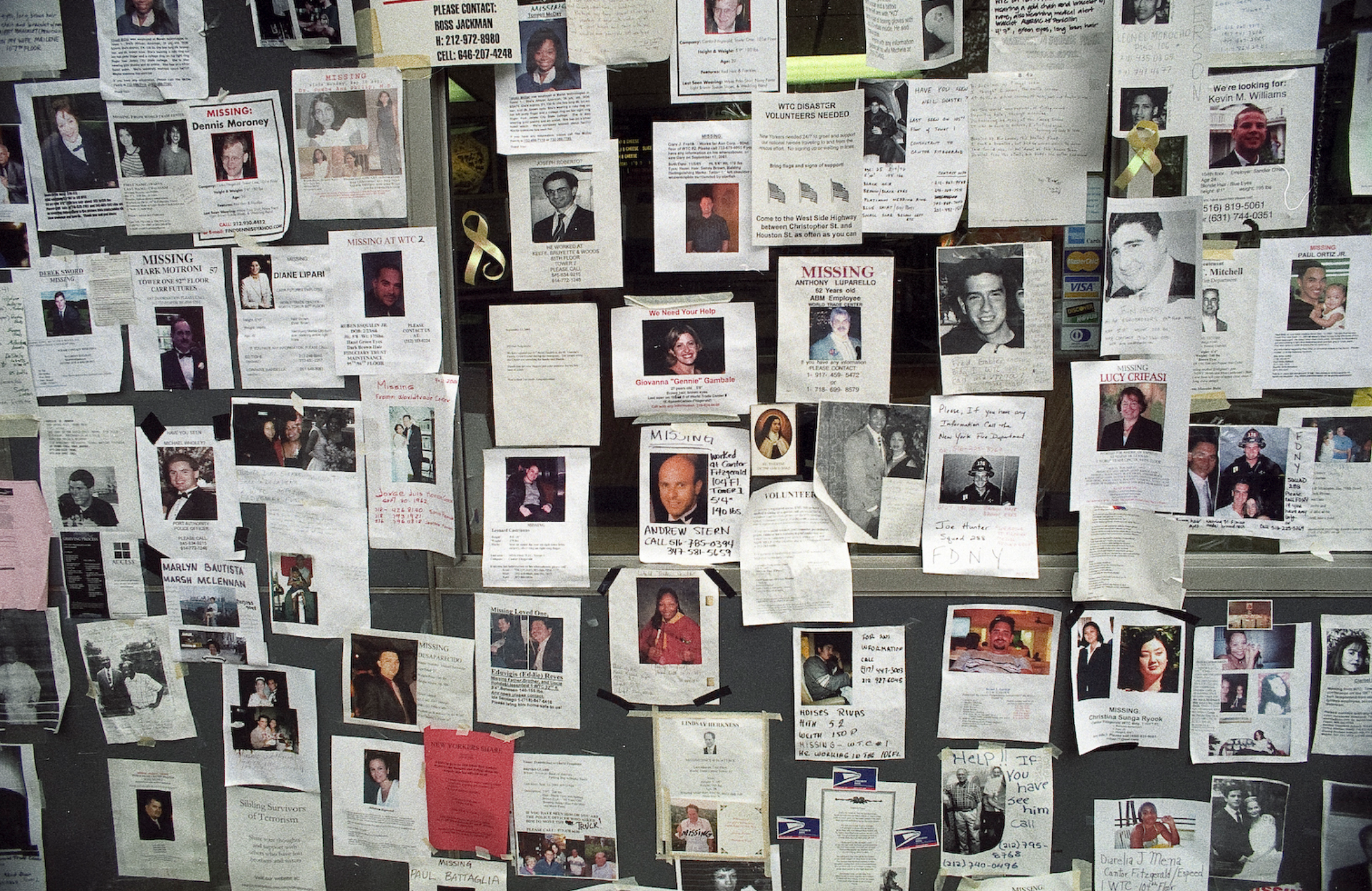 A screenshot of a wall covered with posters of missing people