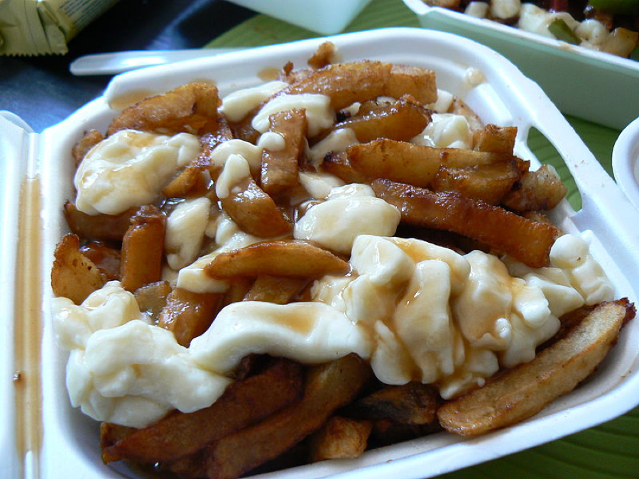 mashed potatoes and fries in gravy