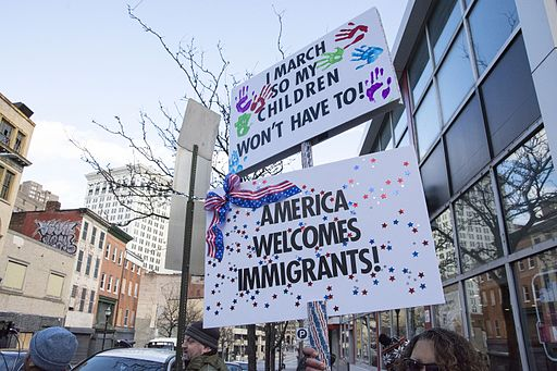 An image of signs at an immigration protest in Baltimore