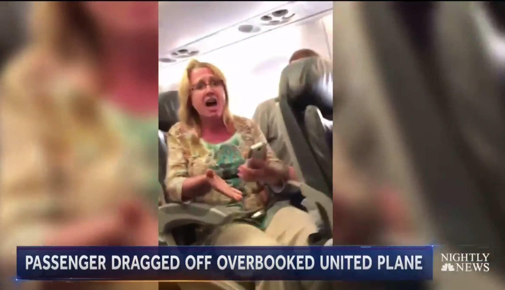 An image of a video on the news of a passenger on a United Airlines flight