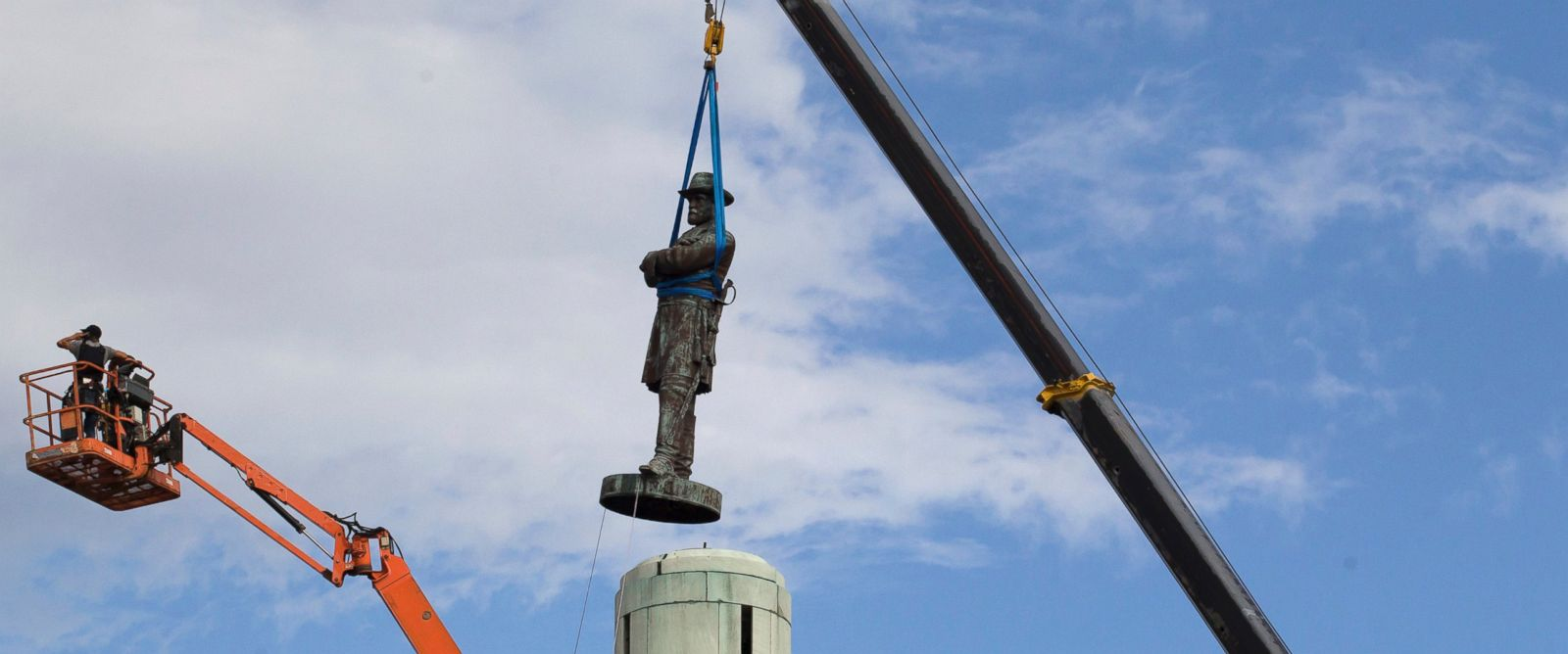 An image of a crane carrying a statue