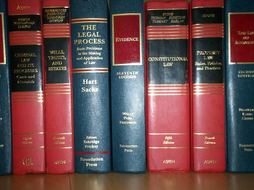 An image of blue and red law books on a shelf