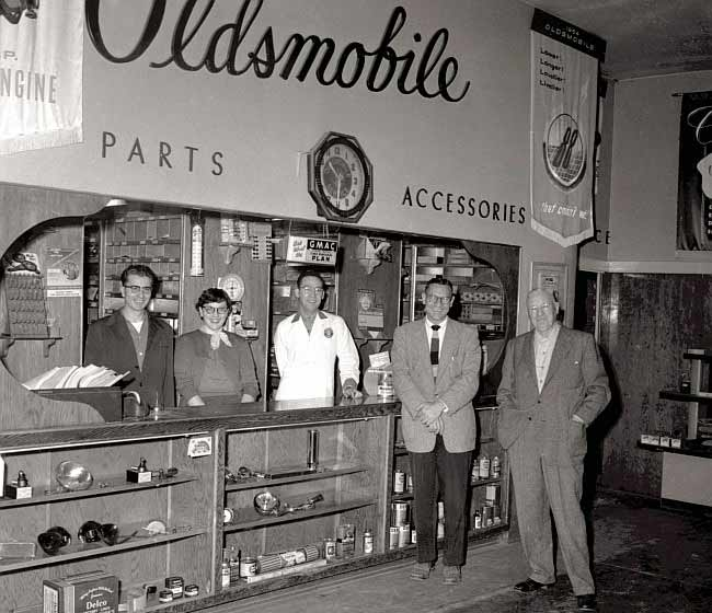An image of workers in Oldsmobile Parts and Accessories