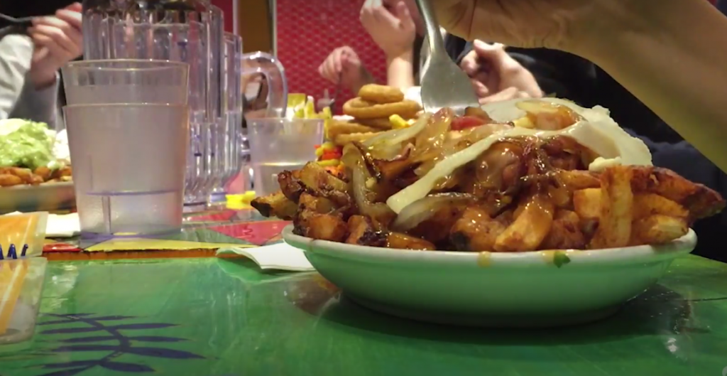 A screenshot of fries on a table along with glasses
