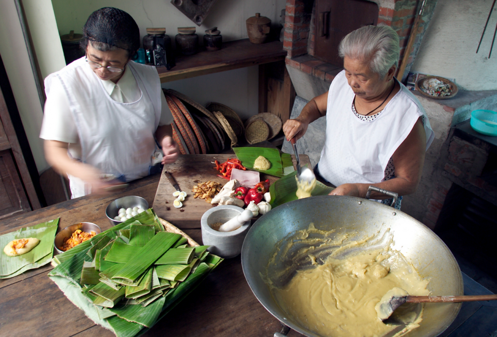 An image of two older women cooking in a kitchen