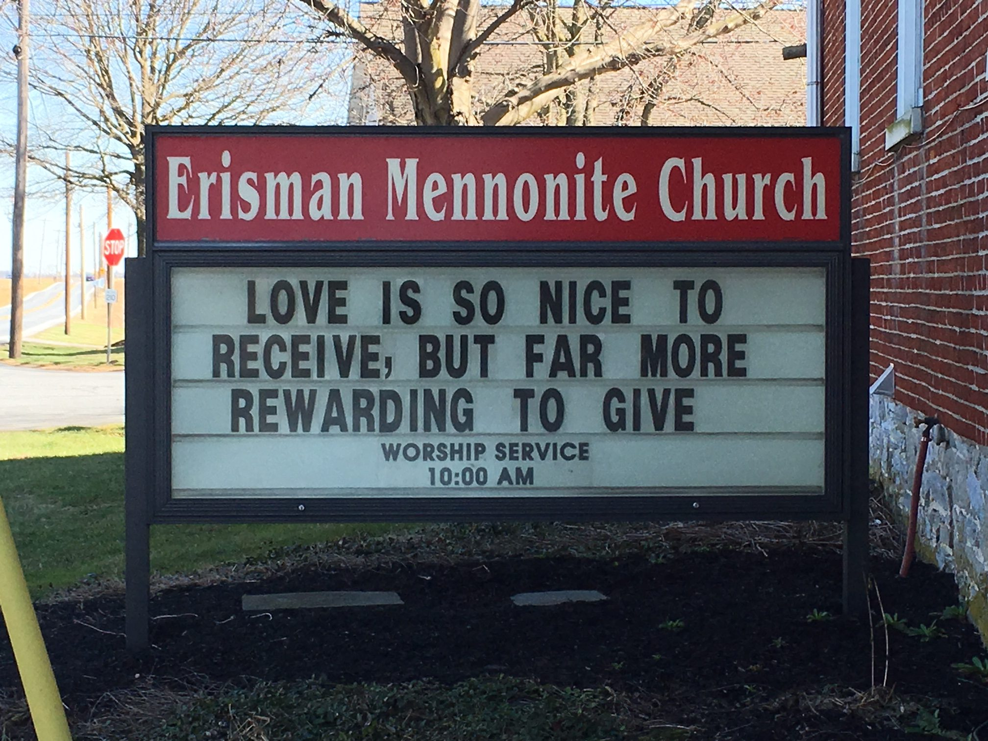 Love is so nice to receive, but far more rewarding to give. Church Sign in front of Irishman Mennonite Church