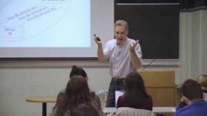 An image of Jordan Peterson teaching in front of a class
