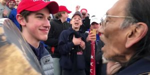 An image of a bunch of young boys and an older man at a Trump rally