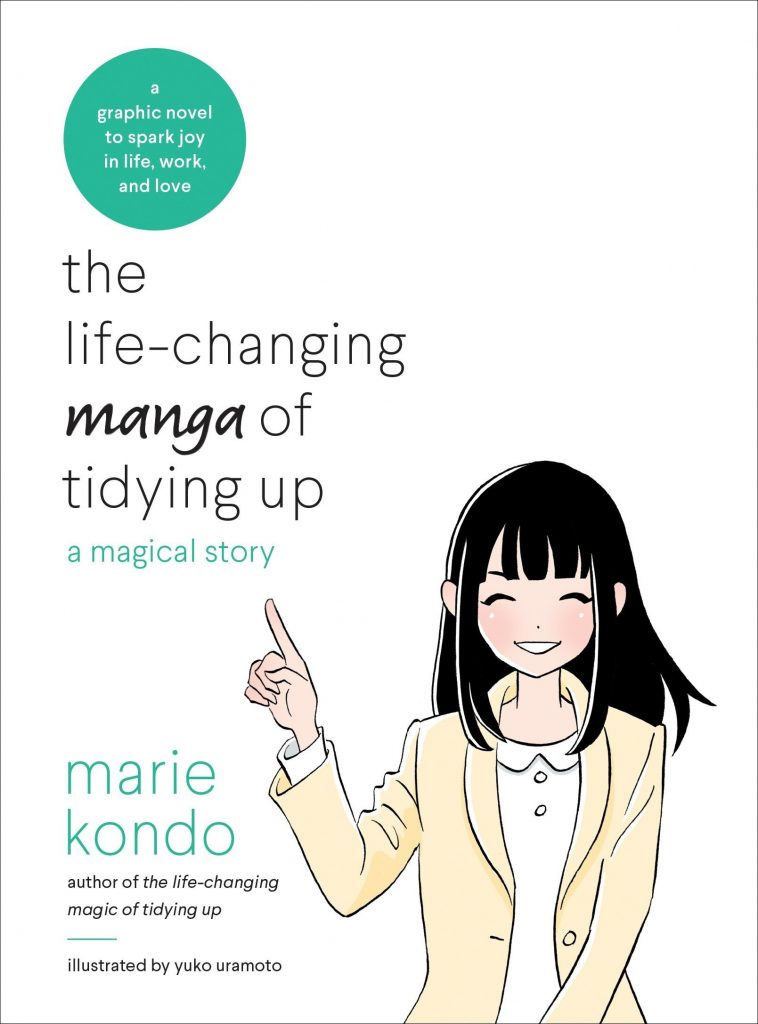 """The Life-Changing Manga of Tidying Up: A Magical Story"" by Marie Kondo, illustrated by Yuka Uramoto. --a graphic novel to spark joy in life and work. Kondo his shown with her hand raised in the air to signify the ""ding"" sound."