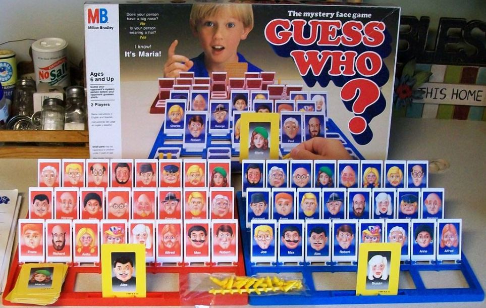 An image of all the pieces that come with the Guess Who Game