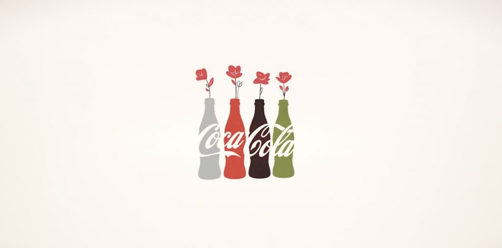 An image of a Coca Cola add with flowers coming out of the bottles