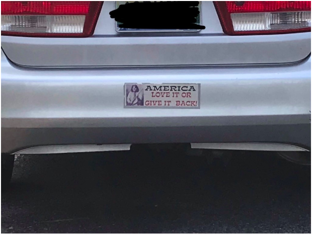 An image of the bumper of a car with a sticker that says